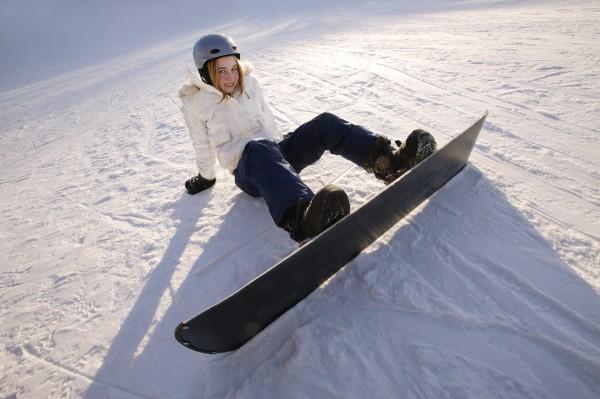 teen on snowboard