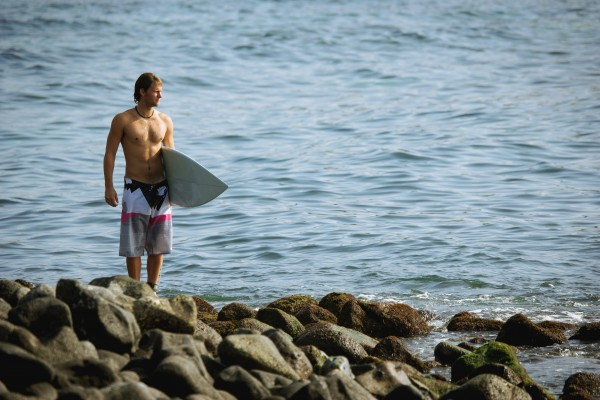 surfer looking out to sea
