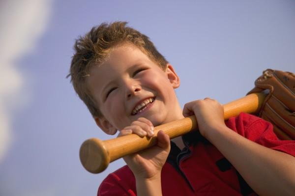 smiling boy with a baseball bat