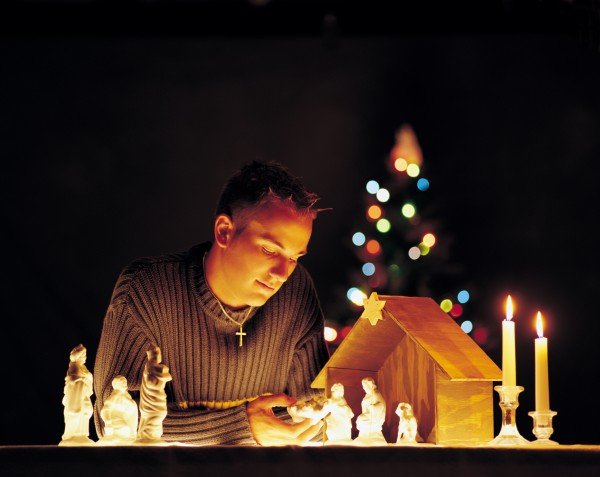 man with nativity scene figurines and