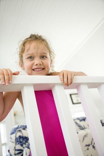 girl peeking over railing