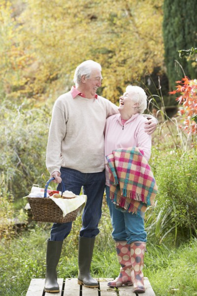 senior couple outdoors with picnic basket