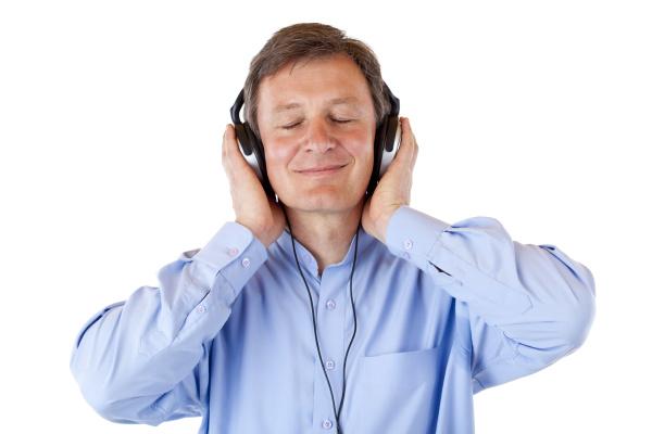 elderly man listening with headphones relish