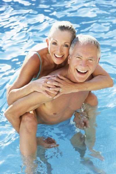 senior couple having fun in pool