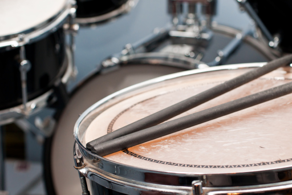 drums with sticks on snare drums