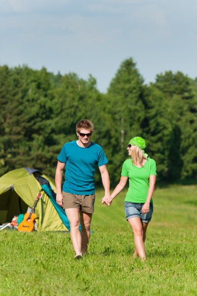 young camping couple hold hands summer