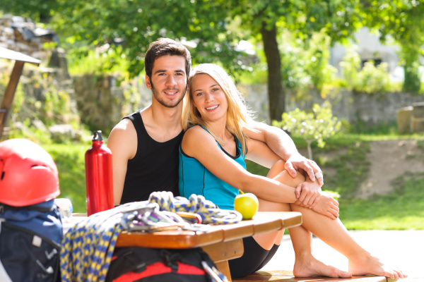 young couple relax sunny terrace climbing
