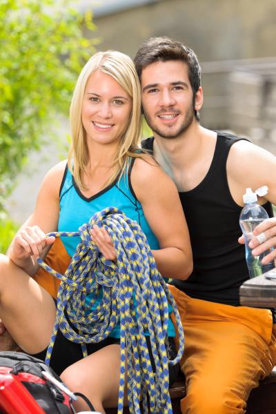 active young couple climbing gear relax