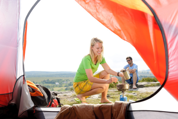 camping young couple outside tent cook