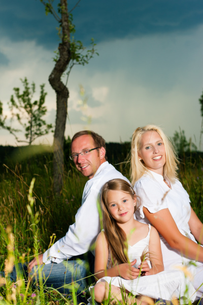 happy family sitting on lawn