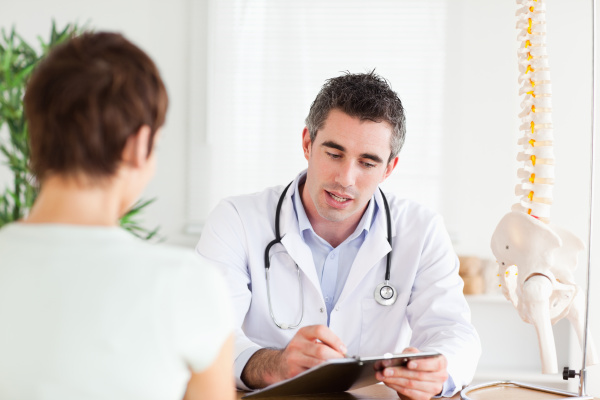 doctor explaining something to a woman