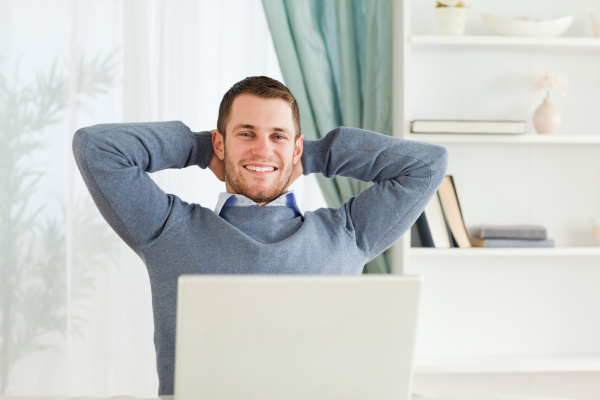smiling businessman leaning back in his