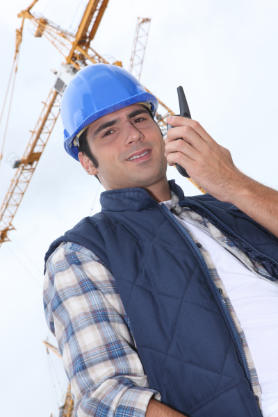 foreman in front of a crane