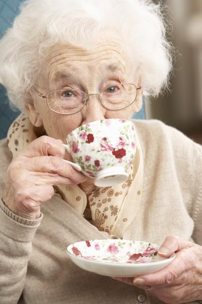 senior woman enjoying cup of tea