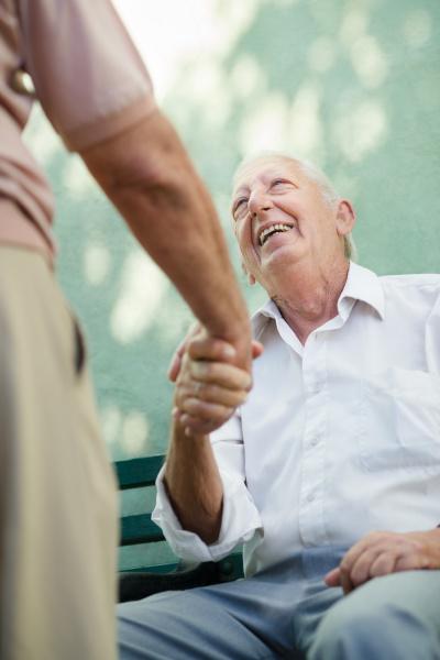 group of happy elderly men laughing