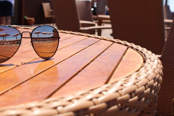 mirrored sunglasses on table