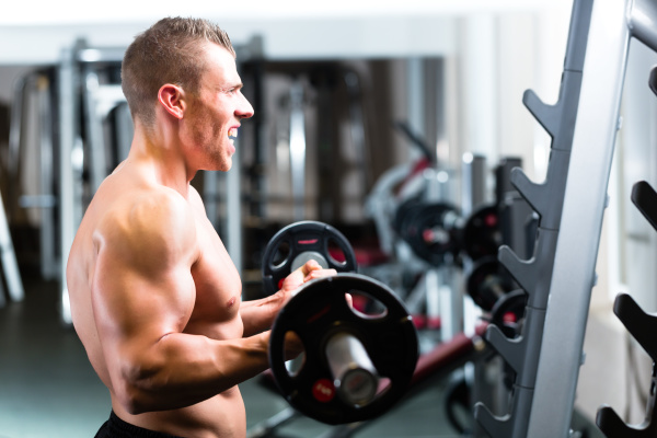 training with dumbbells in the gym
