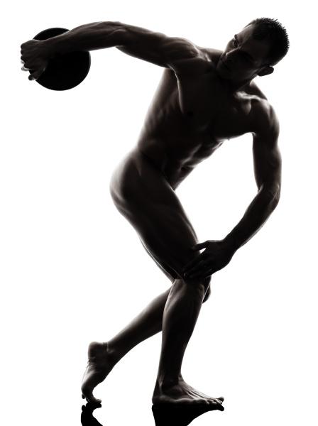 handsome naked muscular man exercising discobolus