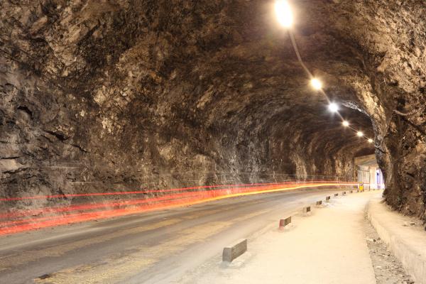narrow illuminated tunnel in gibraltar