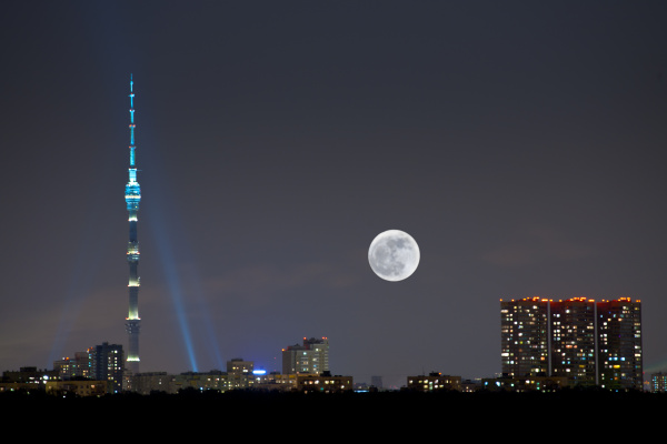 full moon under city