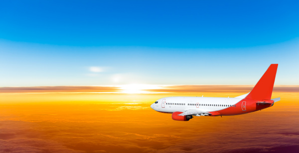 airplane, in, the, sky, at, sunset. - 10026262
