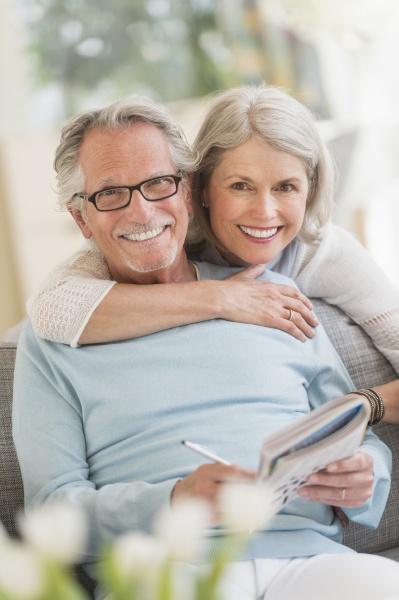 vertical portrait hugging smiling couple senior