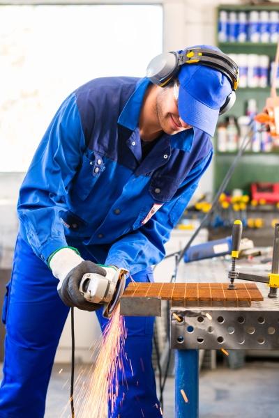 craftsman sawing with disk grinder