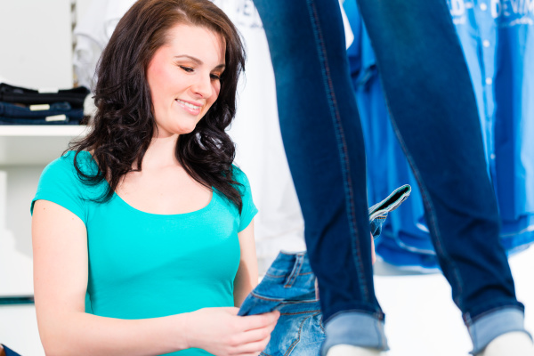 woman buying fashion blue jeans in