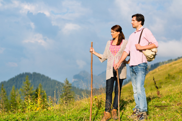 alps couple hiking in
