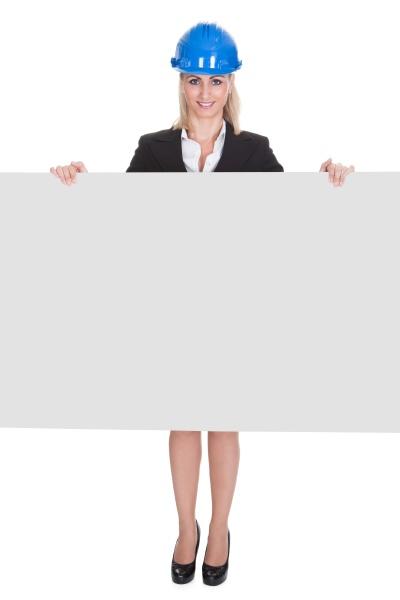 female architect holding placard