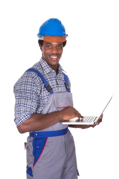 male craftsman holding laptop