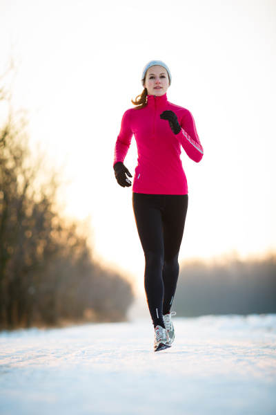 winter running young woman