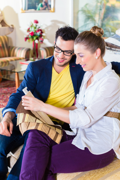 couple picks couch cover in furniture
