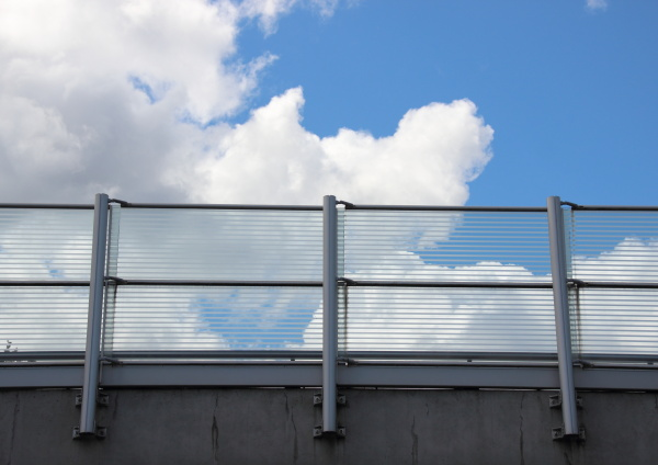 metal and glass railing with blue