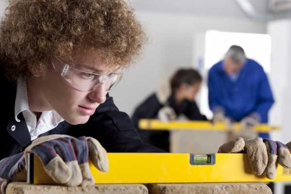 student using level in bricklaying vocational