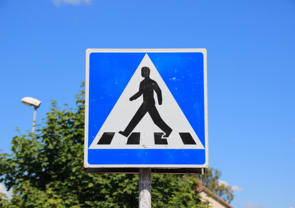 pedestrian sign with blue sky and