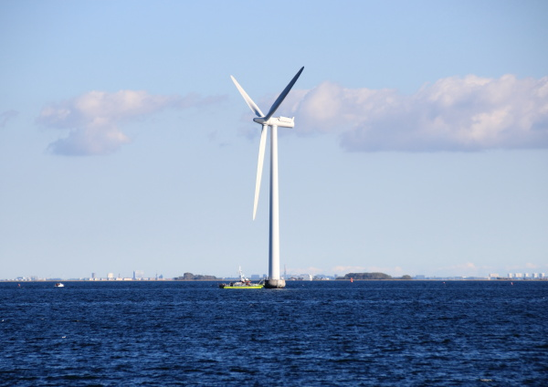 ocean windmill in rough sea with