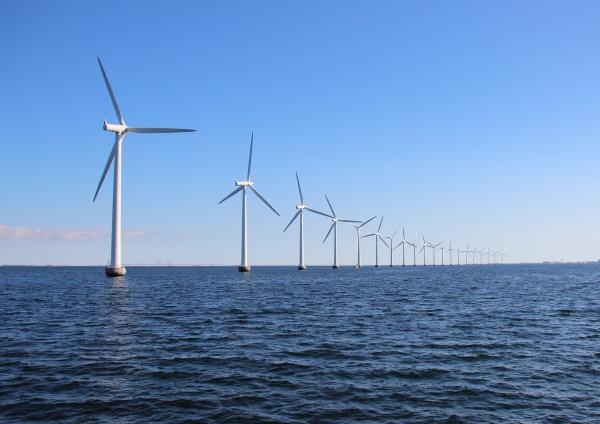 perspective line of ocean wind mills