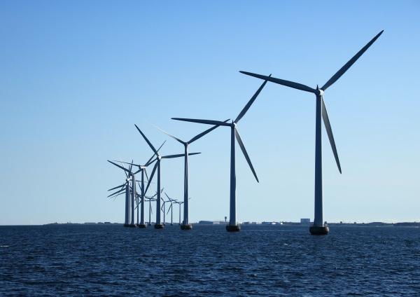 perspective line of ocean windmills in