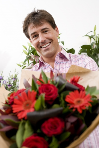 man with bouquet of flowers