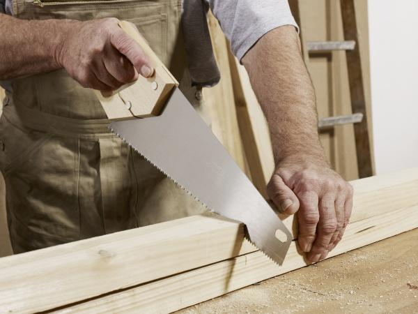horizontal carpentry saw holding profession one