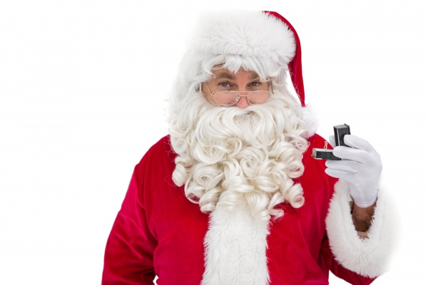 cheerful santa holding a jewelry box