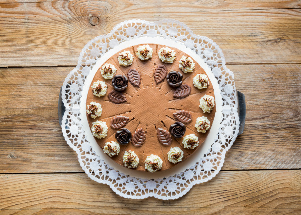 chocolate cream cake on rustic wood