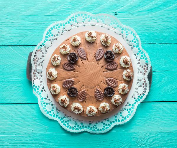 chocolate cream cake on turquoise wood