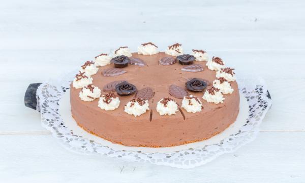 chocolate cream cake on white wood