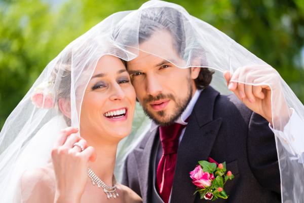 wedding couple under bridal veil