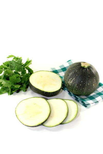round raw zucchini on a checkered