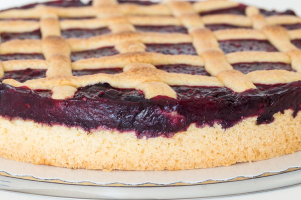 grid cake with wild berries in