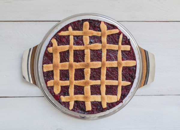 grid cake with wild berries on