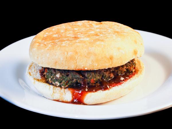 closeup of juicy hamburger between buns